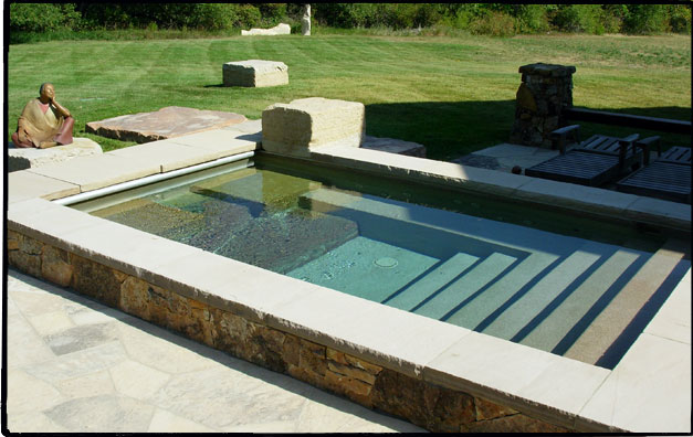 Moss rock veneer side and buff flagstone coping