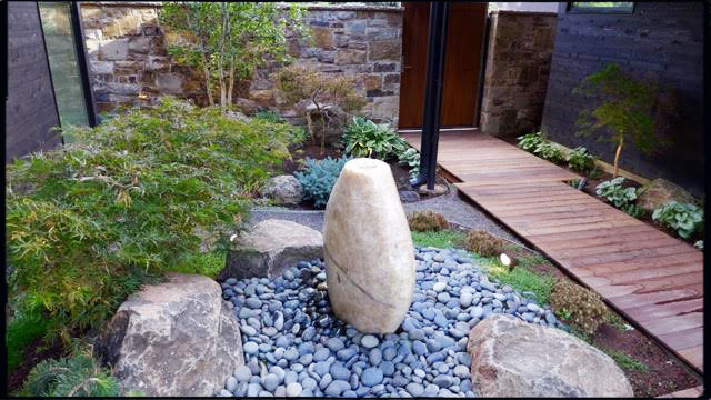Mortared Telluride stone 6 inch veneer. Fountain and landscape by Casey Bynum